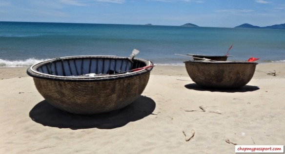 Hoi An fishing boats circular baskets on Cua Dai beach